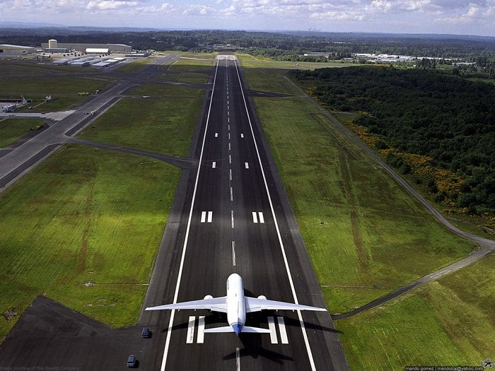 Landing airplane on airport runway.