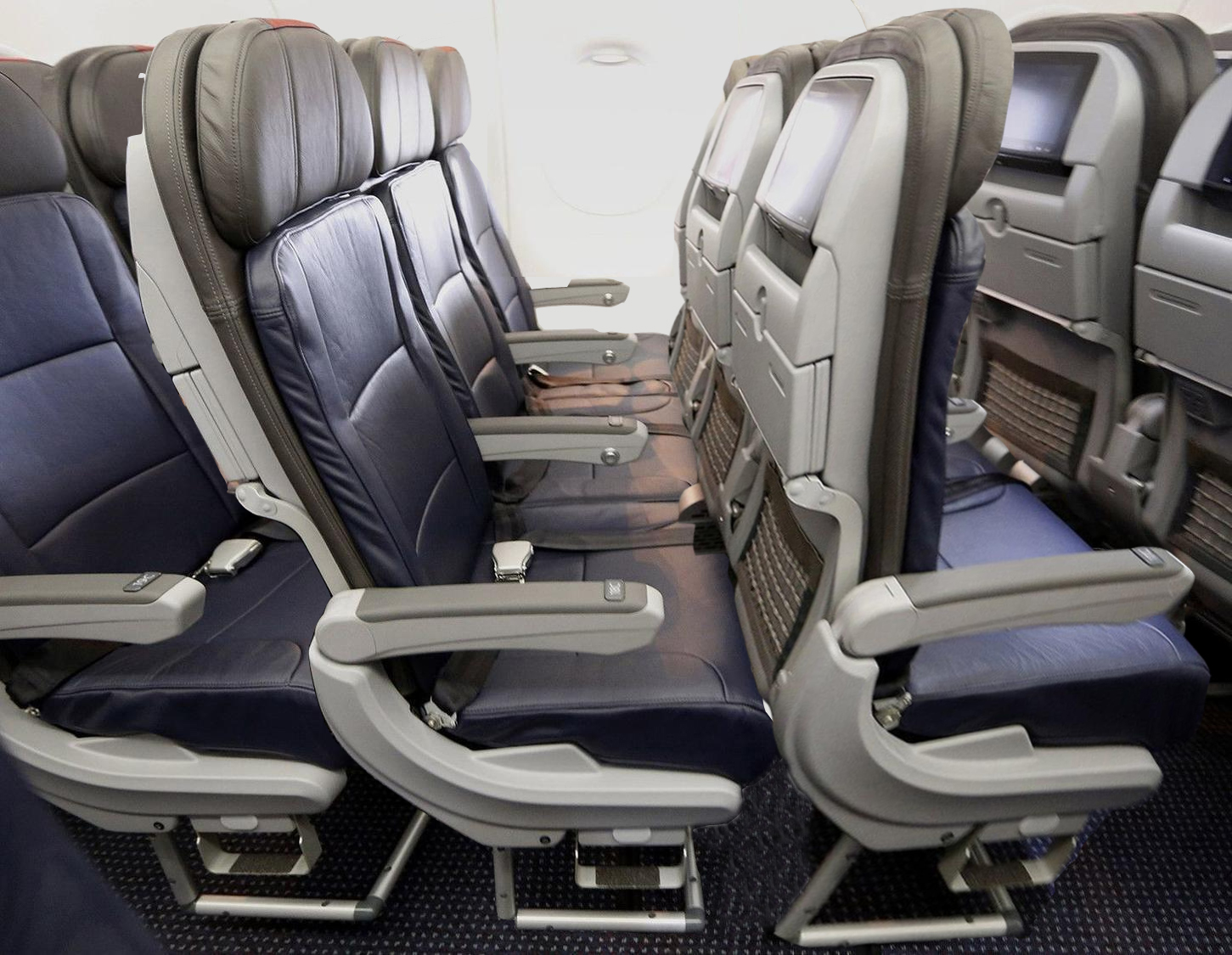 Airline seats leave no room for passengers on their flight at the airport.