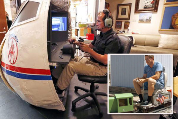 Aviation geek, aka avgeek, pilot playing 737 flight simulator in his hangar. Neighbor has miniature railroad system in his backyard and rides a small train around the property.